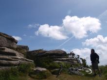 cyclist stops by carn grey rocks