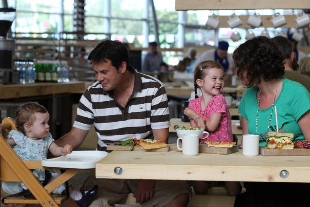 Family enjoying a meal in the Eden Project Bakery